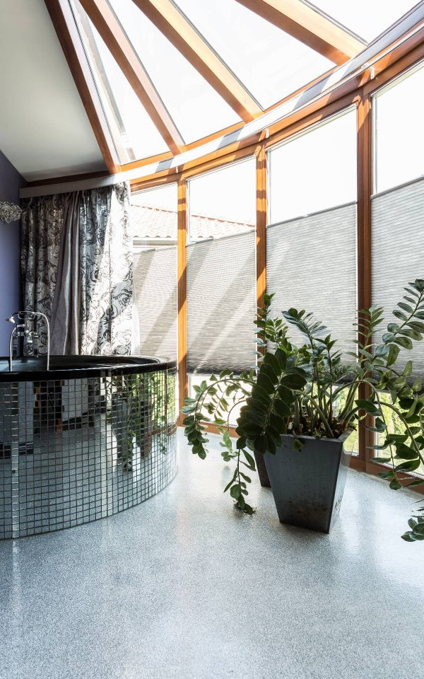 Sophisticated silver bathroom with large windows
